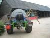 Joskin watertank met arm en slanghaspel om bomen en beplanting van water te voorzien